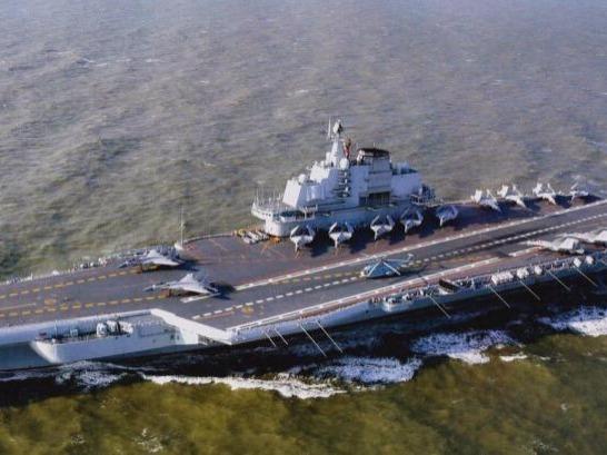 辽宁舰航母编队启航执行跨区机动训练任务